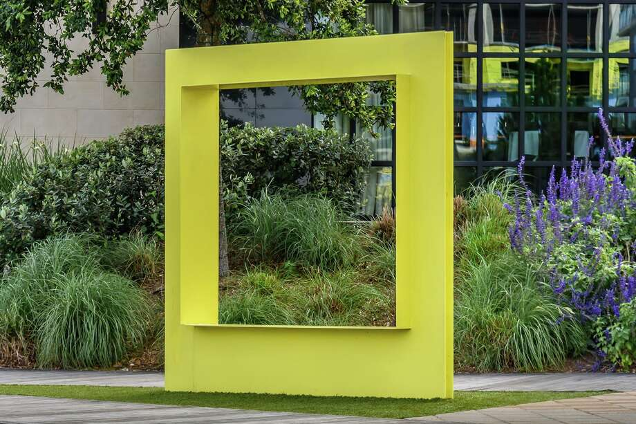Public art and the selfie beautifully collide in the Wind-O sculpture located in Hughes Landing overlooking Lake Woodlands on one side and Restaurant Row on the other. This 8-foot tall and hunky yellow steel aperture was created in 2017 by Miami-based artists Marcelo Ertorteguy and Sara Valente of Stereotank Design Studio. Photo: Courtesy Image/Joan Tilton / Courtesy Image/Joan Tilton / Joan Tilton
