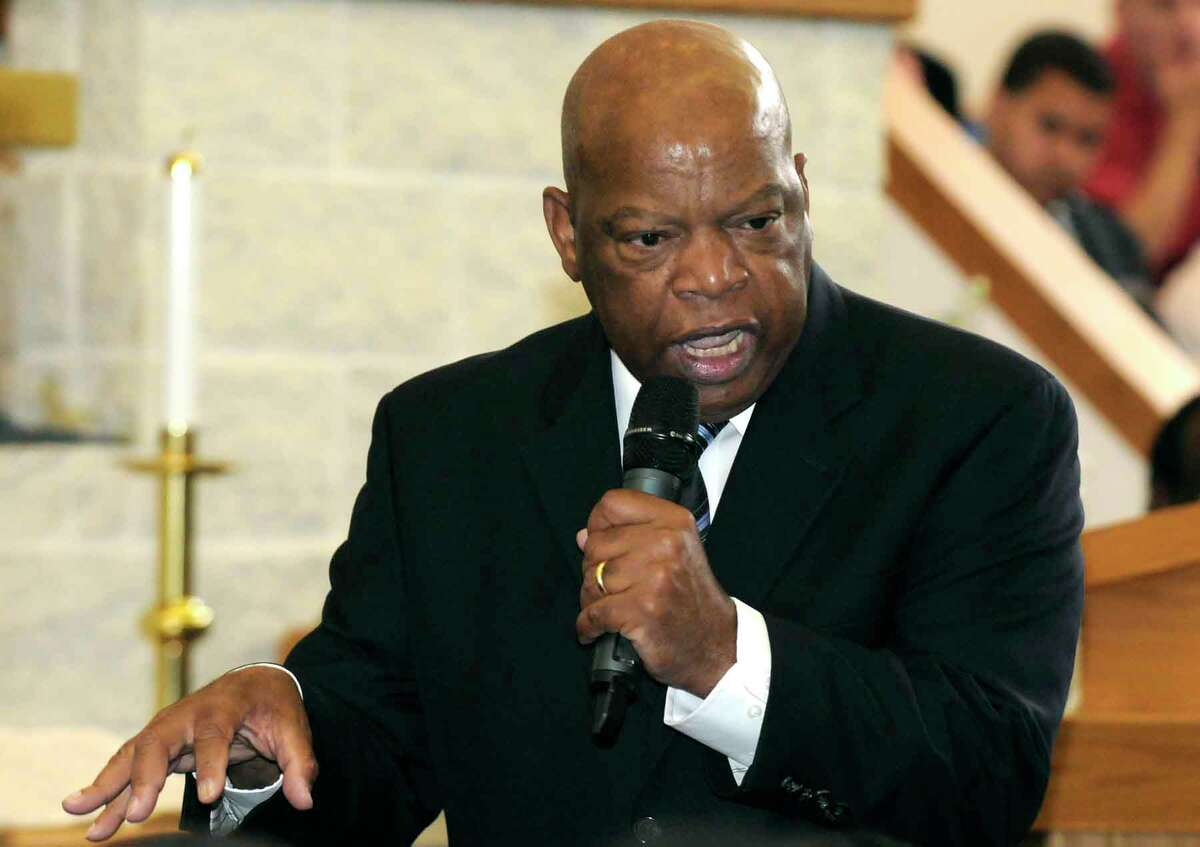 Georgia Congressman and civil rights leader John Lewis , left, speaks at the Mount Olive Southern Missionary in Albany, NY on July 9, 2010. (Times Union archive)