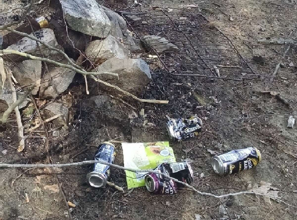 Garbage left near the shore of the Great Sacandaga Reservoir in the Adirondack Park in 2017. (Tim Blydenburgh / Times Union)