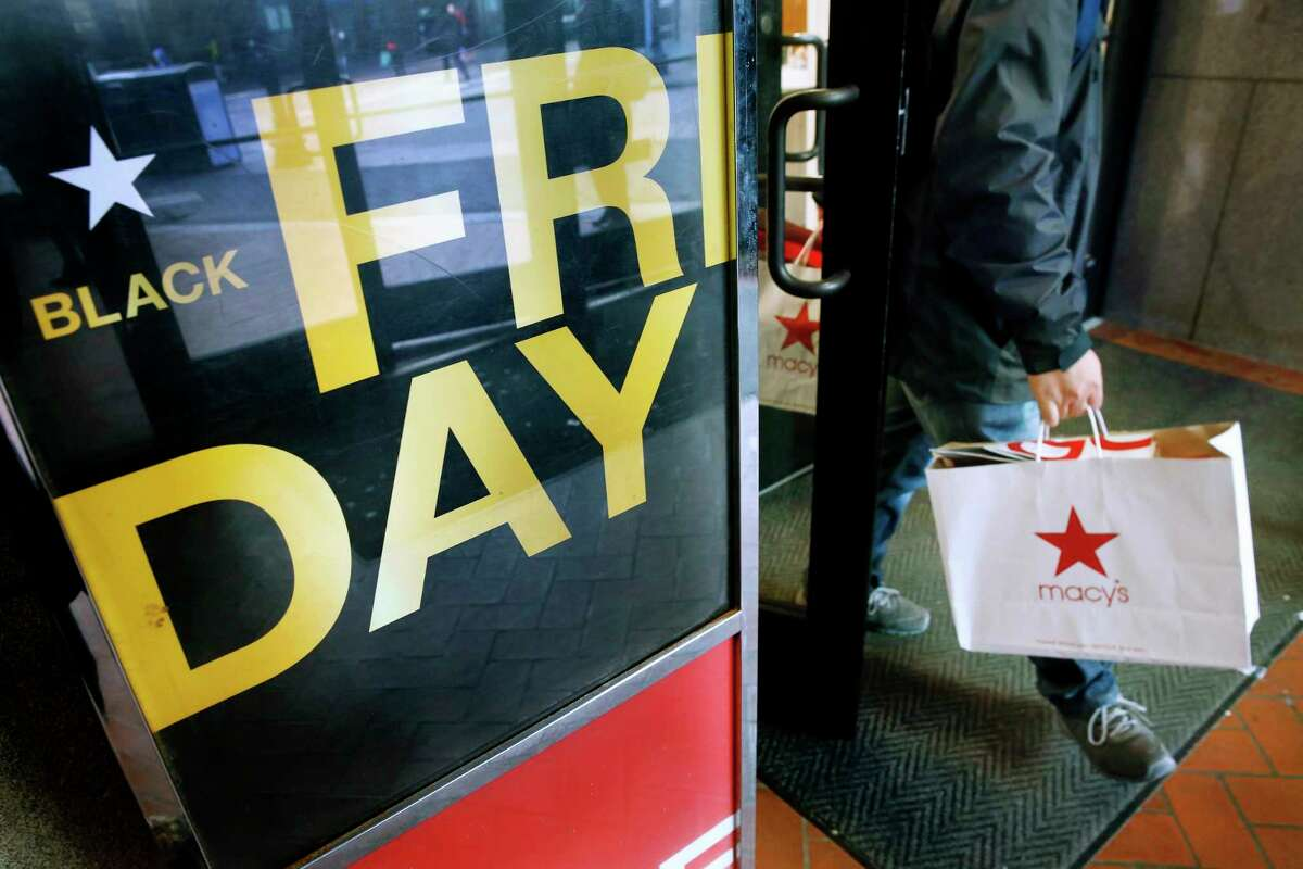 FILE - In this Nov. 29, 2019 file photo, a shopper leaves Macy's in Boston on Black Friday. Ita€™s evident that the retail industry has felt the impacts of the COVID-19 pandemic. But what will that mean for Black Friday shopping? The annual November discount day usually features packed stores, long lines and massive discounts for holiday shoppers. But this yeara€™s Black Friday will be unlike anything wea€™ve seen before. (AP Photo/Michael Dwyer, File)