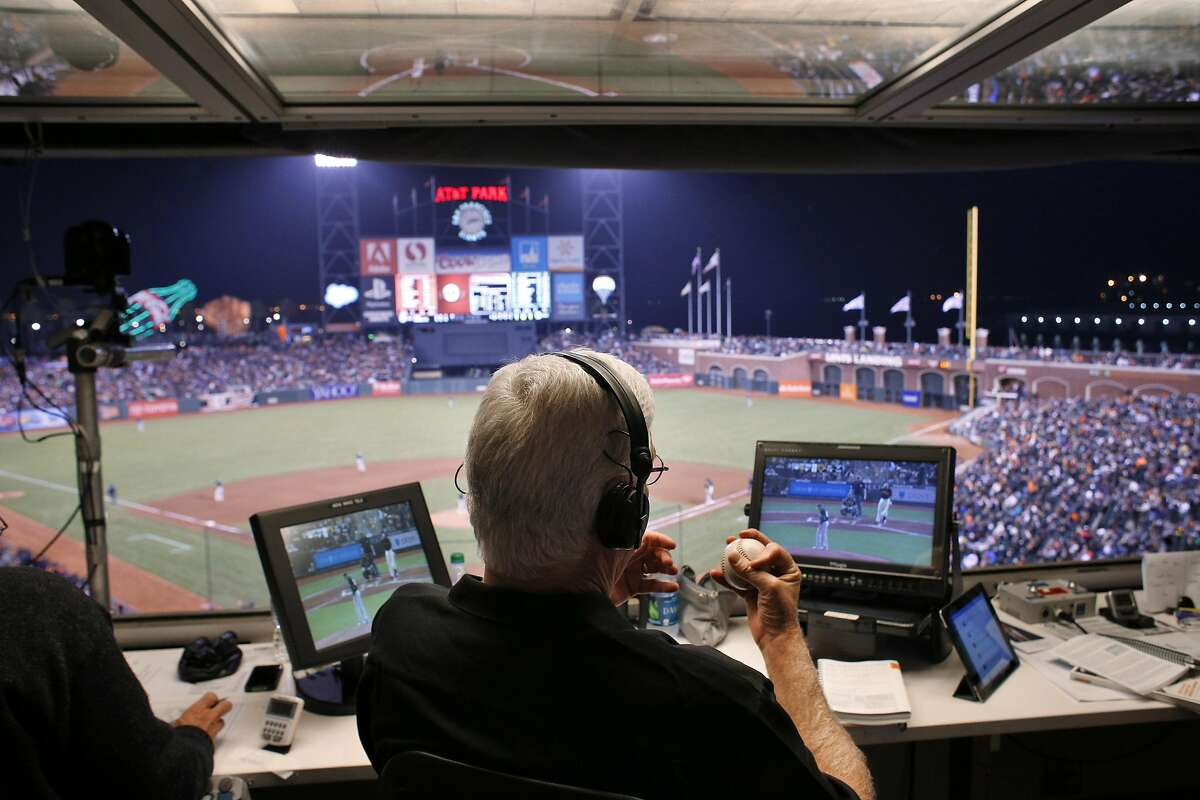 Giants broadcasters Mike Krukow clutches a baseball as he and Jon Miller call the game from the TV booth as the San Francisco Giants played the Oakland Athletics in a pre-season game at AT&T Park in San Francisco, Calif., on Thursday, March 27, 2014. Broadcasters throughout the game are bombarded by countless statistics which dissect a player's success to the finest detail. While some broadcasters use them, others prefer call their games with good old fashioned research done firsthand.
