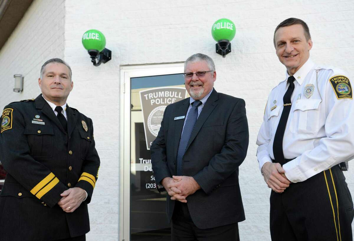 Trumbull Police Chief Michael Lombardo, Westfield Trumbull Manager Patrick Madden and Deputy Chief Glenn Byrnes stand outside the new police substation at the Westfield Trumbull Mall on its first day open Tuesday, Nov. 17, 2015.