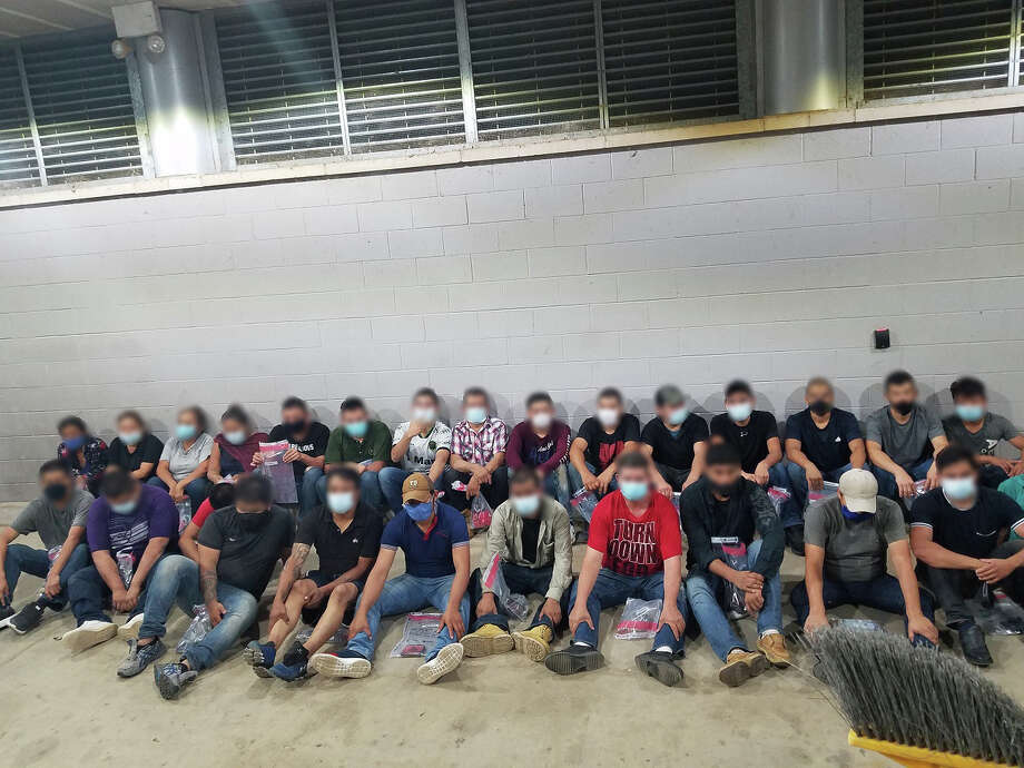 U.S. Border Patrol agents said they discovered these 27 people, including a juvenile, inside a camper trailer. Authorities all had crossed the border illegally. Photo: Courtesy Photo/U.S. Border Patrol