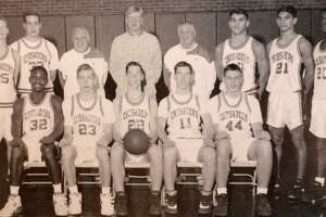 The 1993 FCIAC champion Trinity Catholic boys basketball team, coached by Mike Walsh (center).