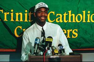 Trinity Catholic's Rashamel Jones announces he will attend UConn on Sept. 26, 1994.