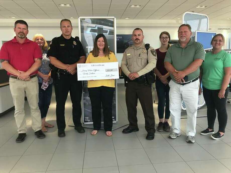 Marshall Chevrolet Buick GMC has provided gift certificates to all members of the Jersey County Sheriff's Office and the Jerseyville Police Department. Pictured are, from left, Craig Billings, Lisa Schwenk, Matt Schultz, Kim Marshall, Jesse Faul, Hannah Yarrington, Stan Hudson and Mandi Smith.