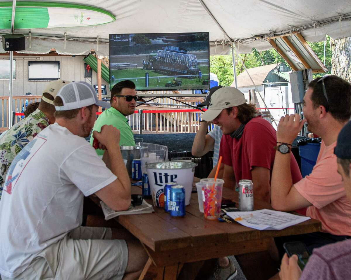 A group of fans could not attend the Saratoga Race Course in person because of the COVID-19 pandemic so they set up camp at the Horseshoe Inn Bar and Grill on Gridley Avenue in Sararoga, NY on Saturday, July 18, 2020 (Jim Franco/special to the Times Union.)