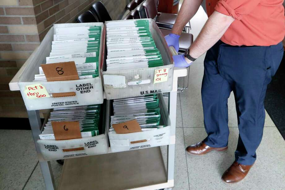 This letter writer gives her opinion about what she feels absentee ballots, (pictured), allow more people in New Canaan to do. Photo: Paul Sancya / Associated Press / Copyright 2020 The Associated Press. All rights reserved