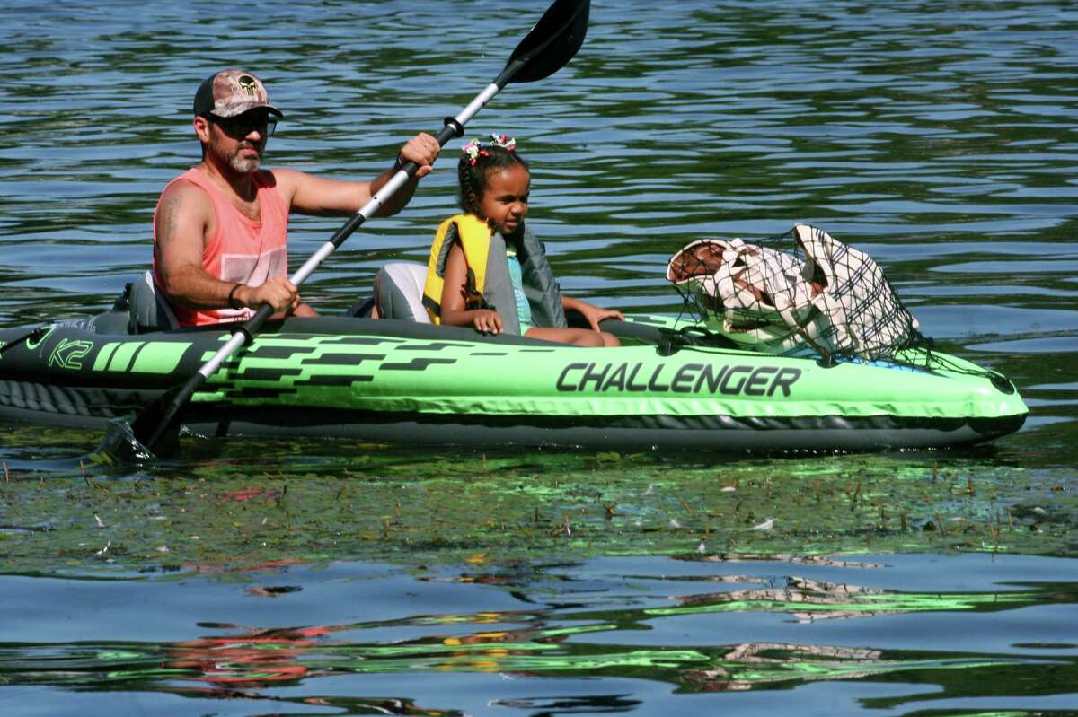 Allen Ferreira and his daughter Sarah, 4, take a ride in a kayak in the Housatonic River at Indian Well State Park in Shelton, Conn., on Saturday July 18, 2020.