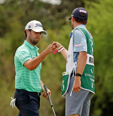 Davis Riley fist bumps caddie Daniel Gregory after a birdie on the 10th hole at GLF Korn Ferry Round 4 at the Oaks in San Antonio, TX 78261 on Saturday, July 18, 2020.