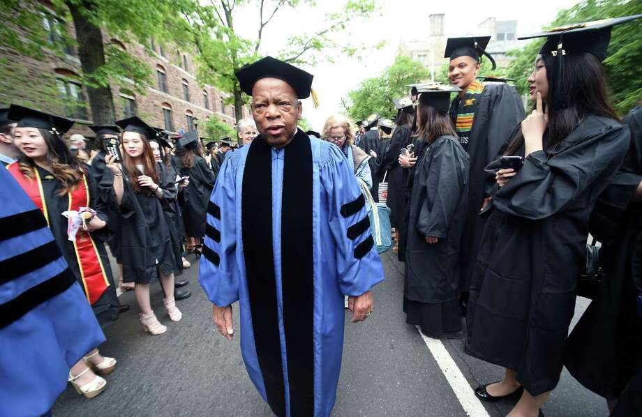 U.S. Rep. John Lewis processes between rows of graduates on Elm Street at Yale University Commencement in New Haven on May 22, 2017. Lewis received an honorary Doctor of Laws degree. Photo: Arnold Gold / Hearst CT Media