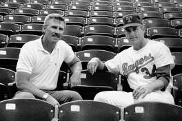 Bill Gilbreth visits with his friend Nolan Ryan before a game at old Arlington Stadium.