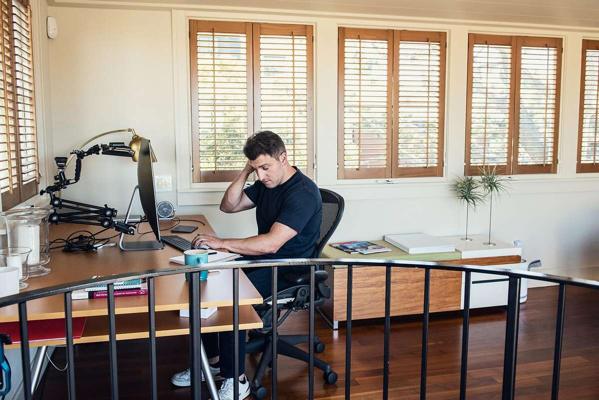 Brian Chesky, CEO of Airbnb, working at his home in San Francisco, June 8, 2020. After laying off 1,900 employees, Airbnb was thrust into the center of a growing debate in Silicon Valley: What happens when a company that has positioned itself as family to its employees reveals that it is just a regular business with the same capitalist concerns � namely, survival � as any other? (Jessica Chou/The New York Times)