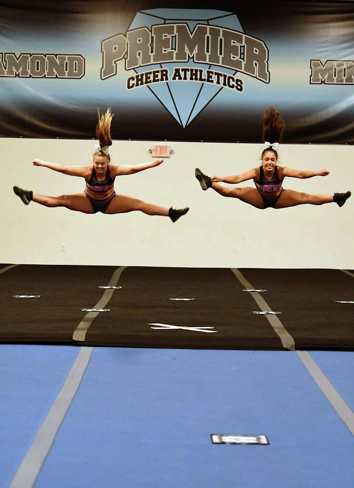 Alex Joslyn, 15, of Latham, left, and Miranda Diaz, 14, of Albany, practice during tryouts for the group's hip-hop competitive team at Premier Cheer Academy on Friday, July 17, 2020 in Albany, N.Y. (Lori Van Buren/Times Union7