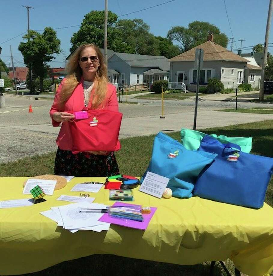 Reference librarian Carol Shively showcases new memory care kits offered at the Manistee County Public Library. (Courtesy Photo/Carol Shively)