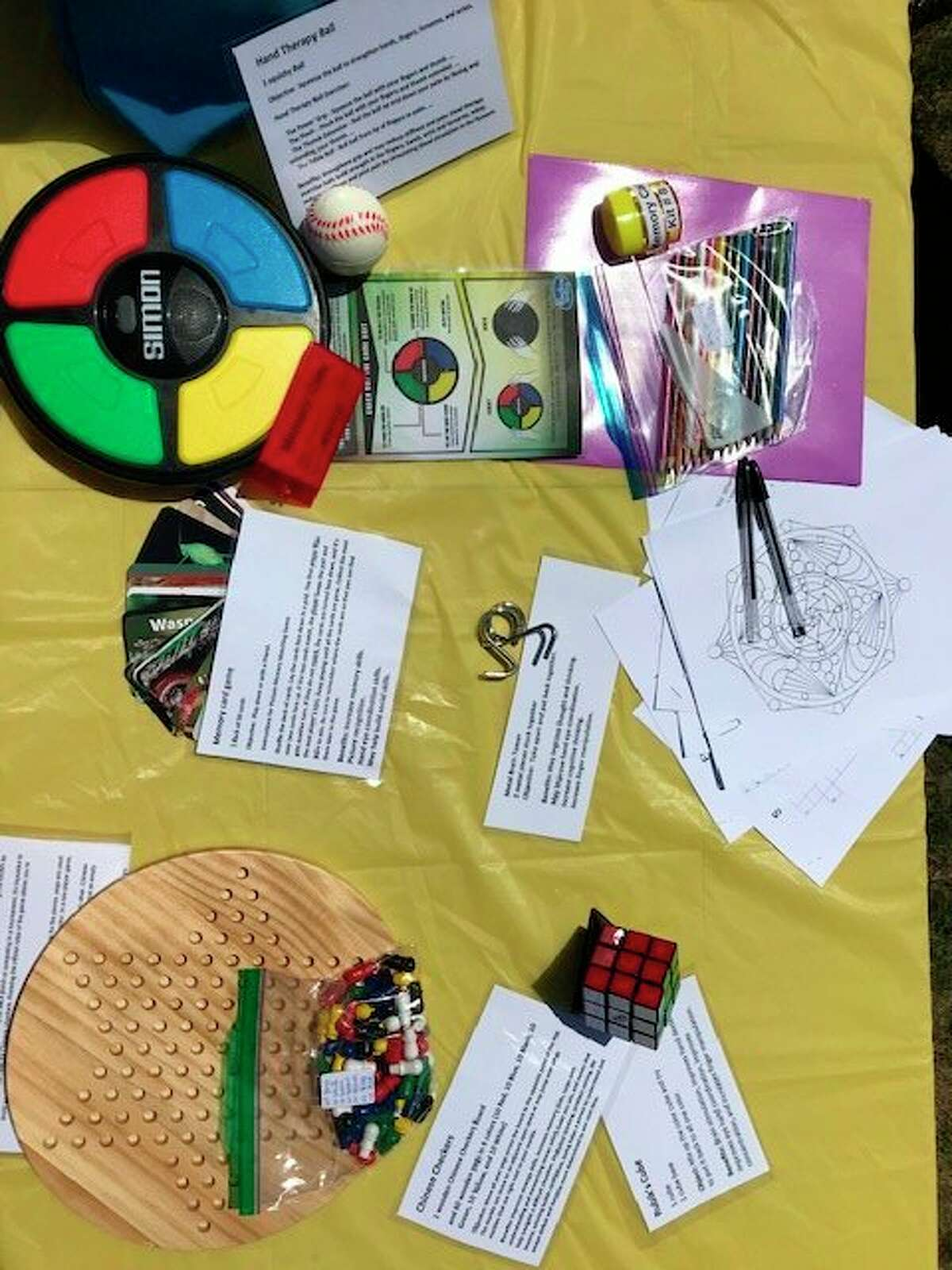Memory care kitsavailable at the Manistee CountyLibrary include games and puzzles that may improve memory and cognition.(Courtesy Photo/Carol Shively)