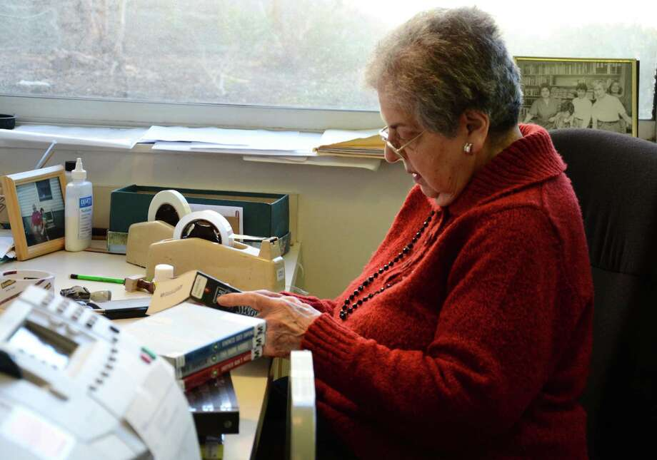 Mary Tiani, a longtime New Canaan resident, and a beloved colleague, and friend of the New Canaan Library, processes books at the library during a recent spring. Tiani processed, and mended books, and DVDs for the library for 50 years. The library has shared news of the passing of Tiani, who recently died at the age of 96. Photo: Nelson Oliveira / Hearst Connecticut Media / New Canaan News