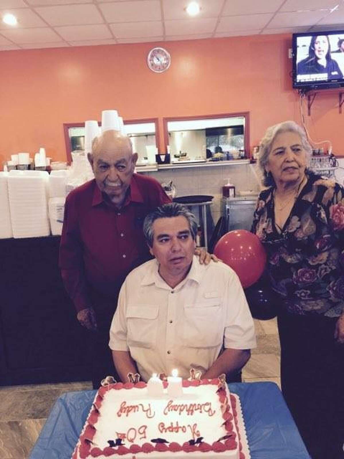 Alfonso Rodriguez and Porfiria Rodriguez celebrate their son Rudy's birthday.