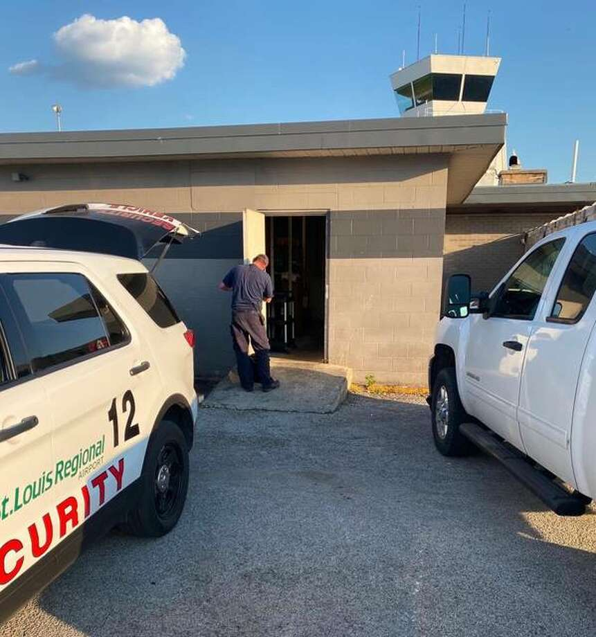 In this June 18 photo, officials secure the High Flyers Grille at the St. Louis Regional Airport. Airport officials and the partners who operated the grille differ over why the business closed. Photo: Submitted|For The Telegraph