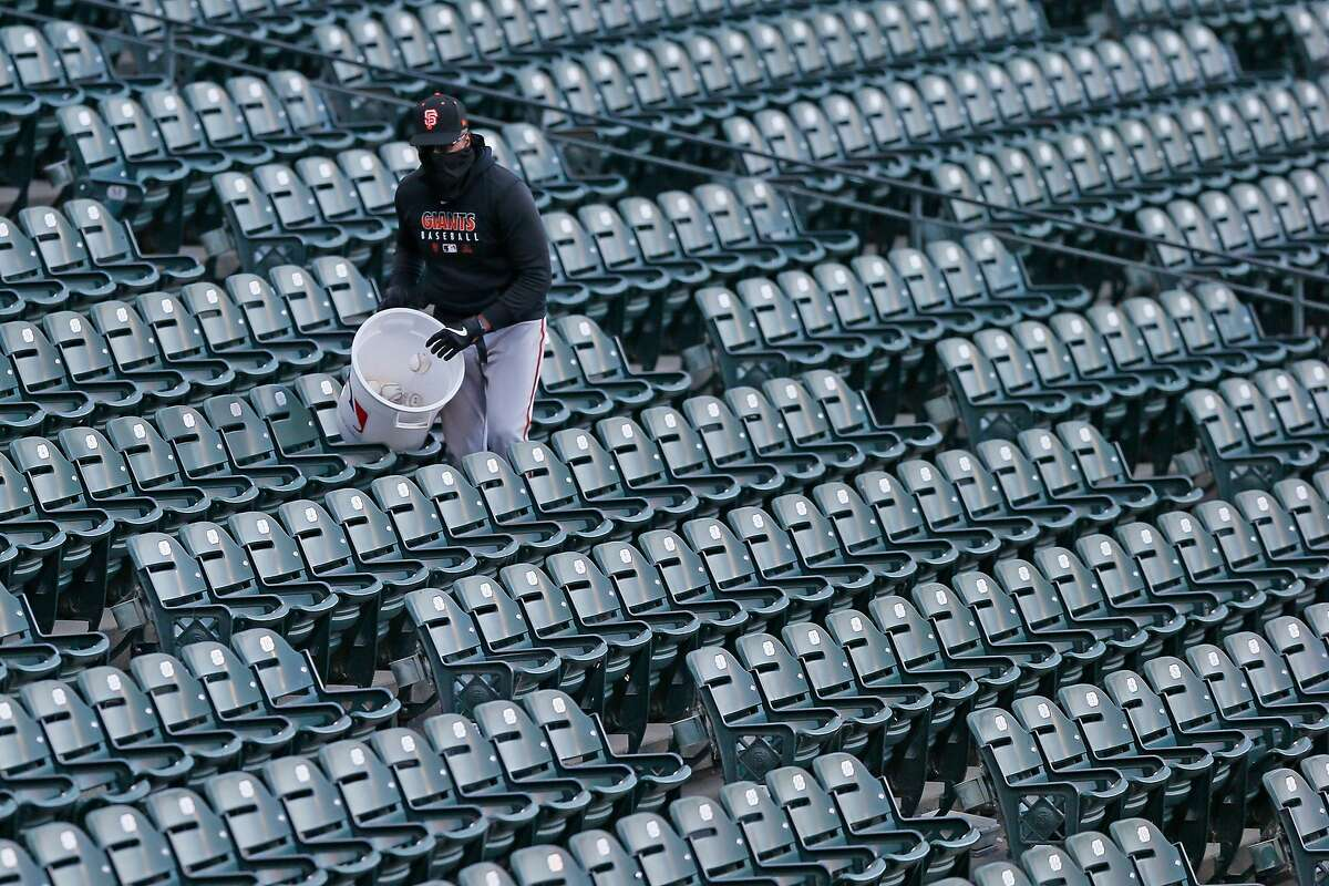 Foul balls are put into a used bin during a San Francisco Giants intrasquad game at Oracle Park on Saturday, July 18, 2020, in San Francisco, Calif. The balls won?•t be used in the game anymore to prevent the spread of germs and viruses, amid the coronavirus pandemic.
