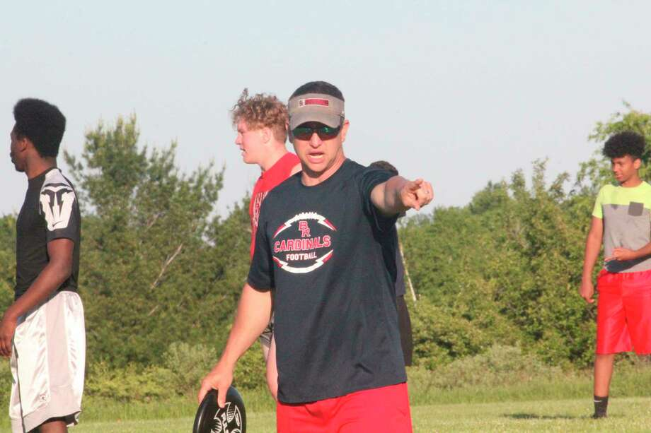 Big Rapids football coach Mike Selzer directs his players during a recent conditioning session. Selzer and other coaches are still hoping to start their practices on time Aug. 10 for football and Aug. 12 for other sports. (Pioneer file photo)