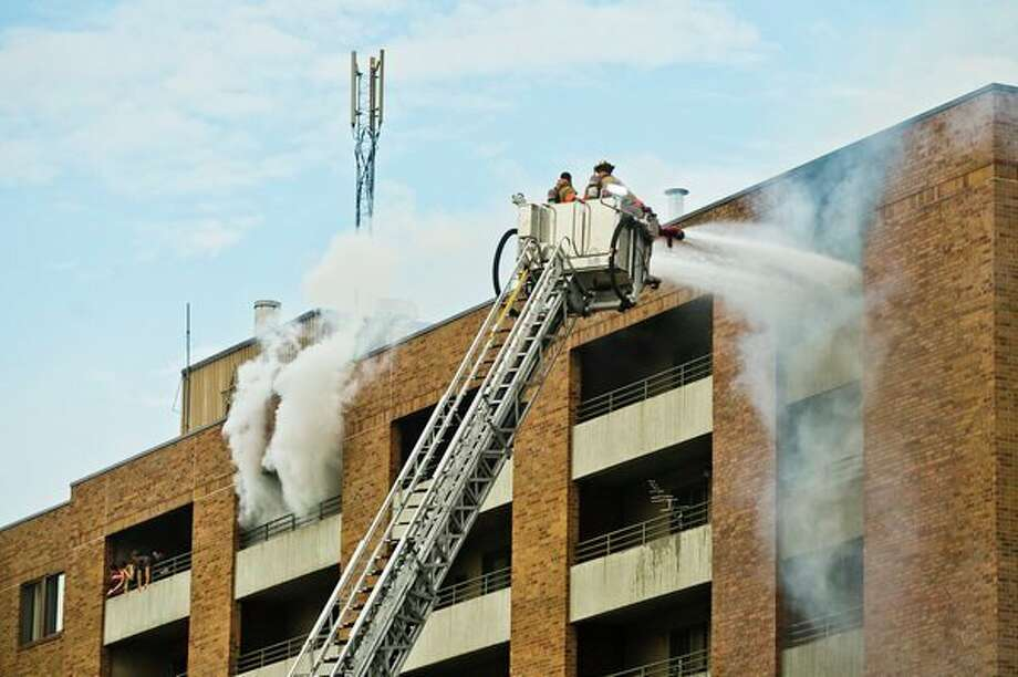Midland firefighters battle a fire at Green Hill Apartments, 1010 Eastlawn Drive, on July 31, 2017. (Daily News file photo/Katy Kildee/kkildee@mdn.net)