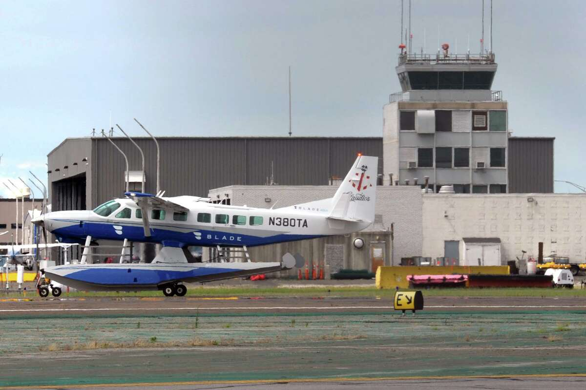 A chartered seaplane taxis past the control tower after landing at Sikorsky Memorial Airport, in Stratford, Conn. July 15, 2020.