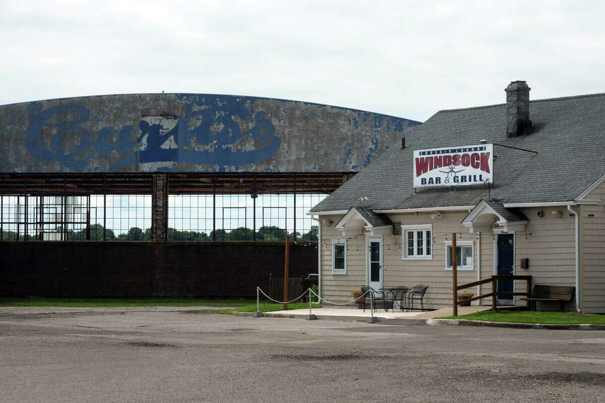 The old Curtis Aviation hangar and Windsock Bar and Grill are two structures still standing from the original Bridgeport Airport, known now for generations as Sikorsky Memorial Airport, in Stratford, Conn. July 15, 2020.