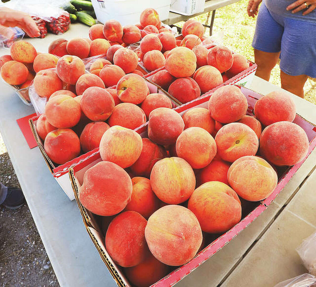 """FILE - No local farmer's market would be complete without an abundance of """"Calhoun Peaches."""""""