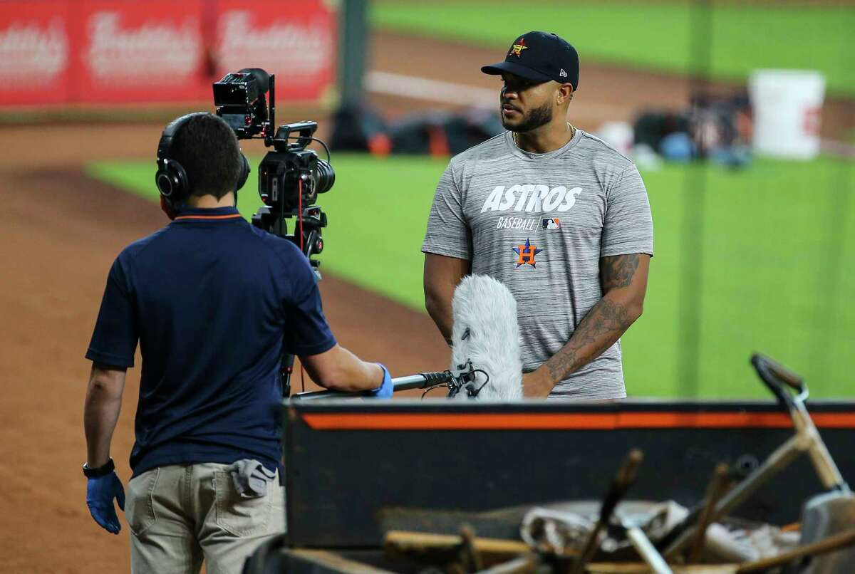 Houston Astros pitcher Josh James records a video on the sideline during the final workout before heading to Kansas City for two exhibition games Sunday, July 19, 2020, at Minute Maid Park in Houston.