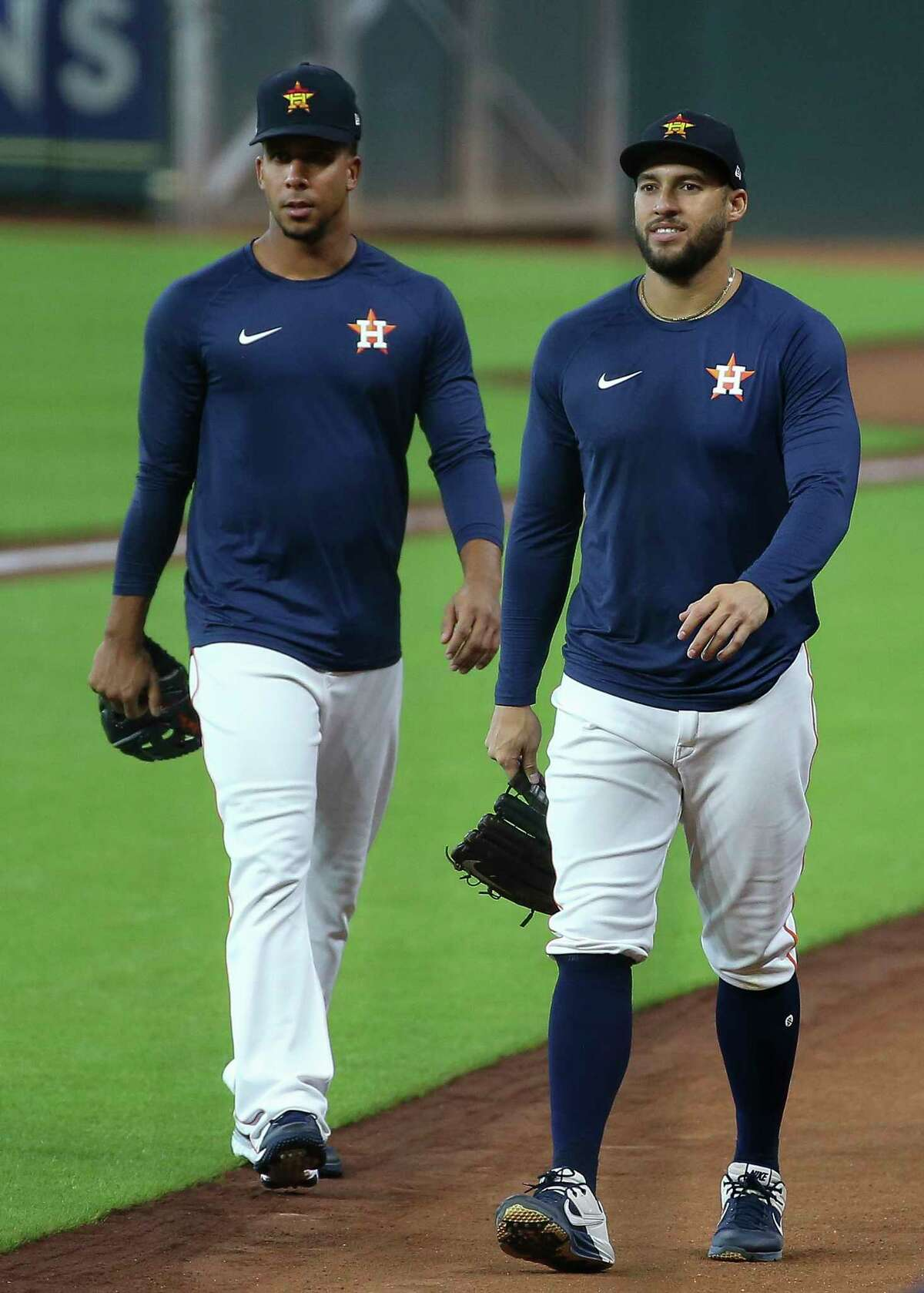 Houston Astros outfielders Michael Brantley, left, and George Springer wrap up the final workout before heading to Kansas City for two exhibition games Sunday, July 19, 2020, at Minute Maid Park in Houston.