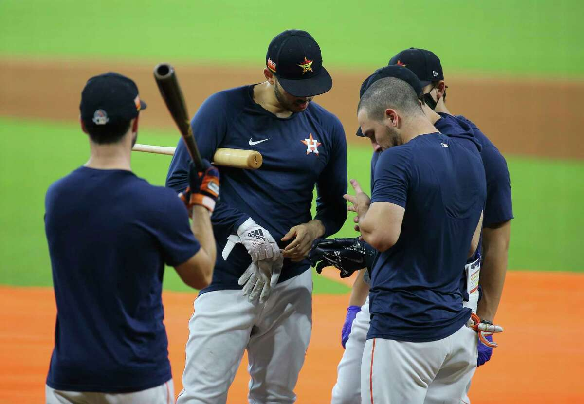 Houston Astros shortstop Carlos Correa reviews his batting videos at the final workout before heading to Kansas City for two exhibition games Sunday, July 19, 2020, at Minute Maid Park in Houston.
