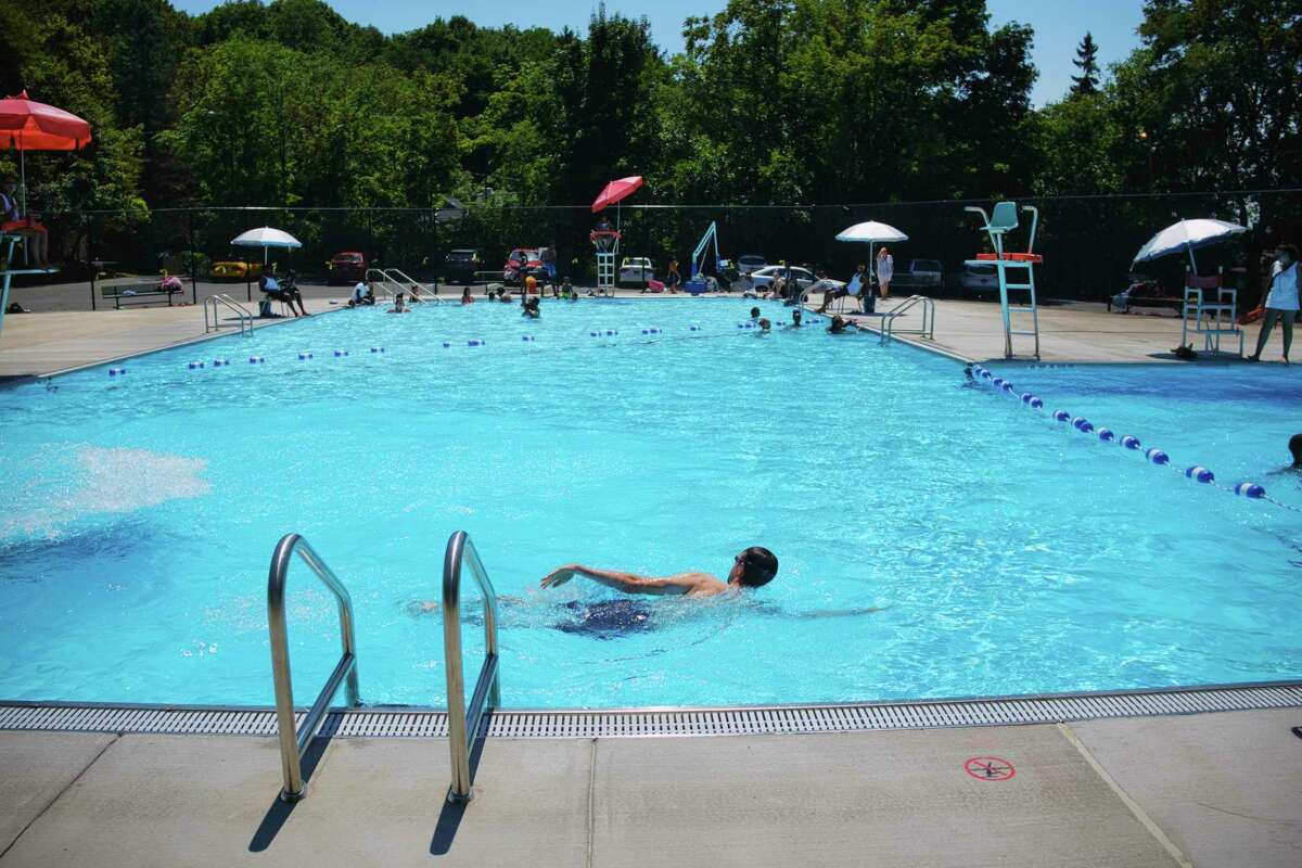 Adults and children cool off in the newly opened South Troy Pool on Sunday, July 19, 2020, in Troy, N.Y. (Paul Buckowski/Times Union)