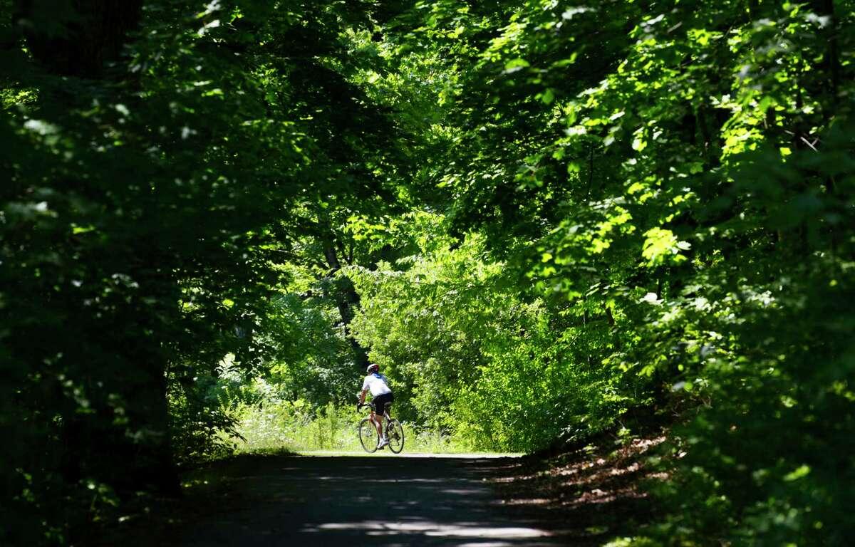 A rider pedals down the bike trail on Sunday, July 19, 2020, in Niskayuna, N.Y. (Paul Buckowski/Times Union)