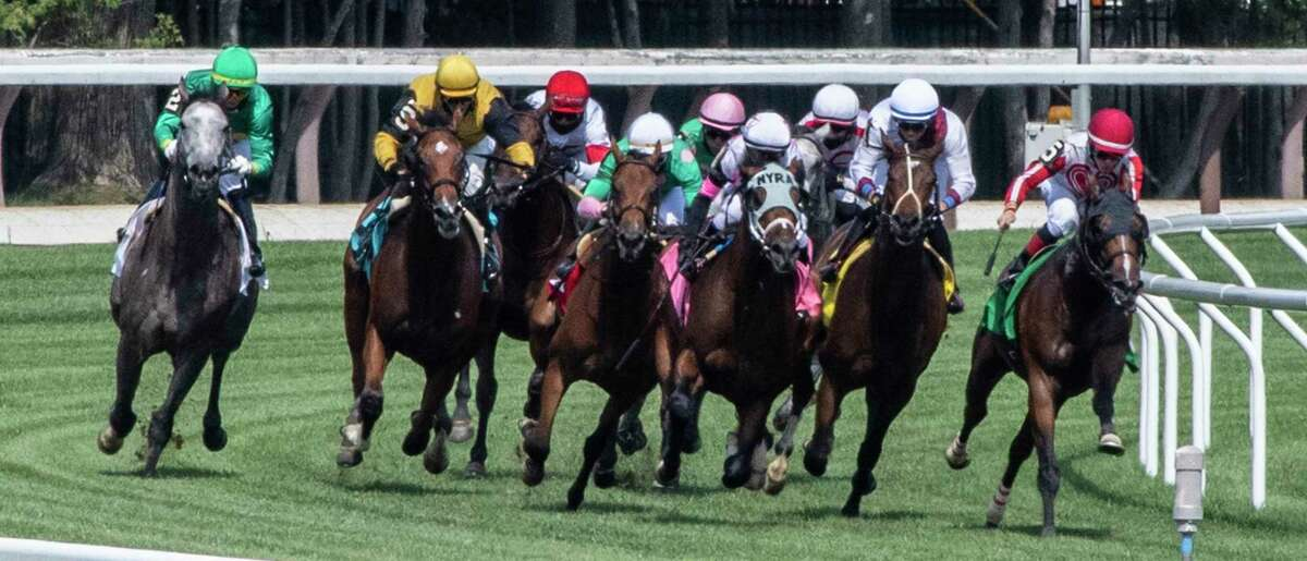 The field of horses sweep around the final turn in the fifth race on the card at Saratoga Race Course July 19, 2020 in Saratoga Springs, N.Y. Photo by Skip Dickstein/Special to the Times Union.