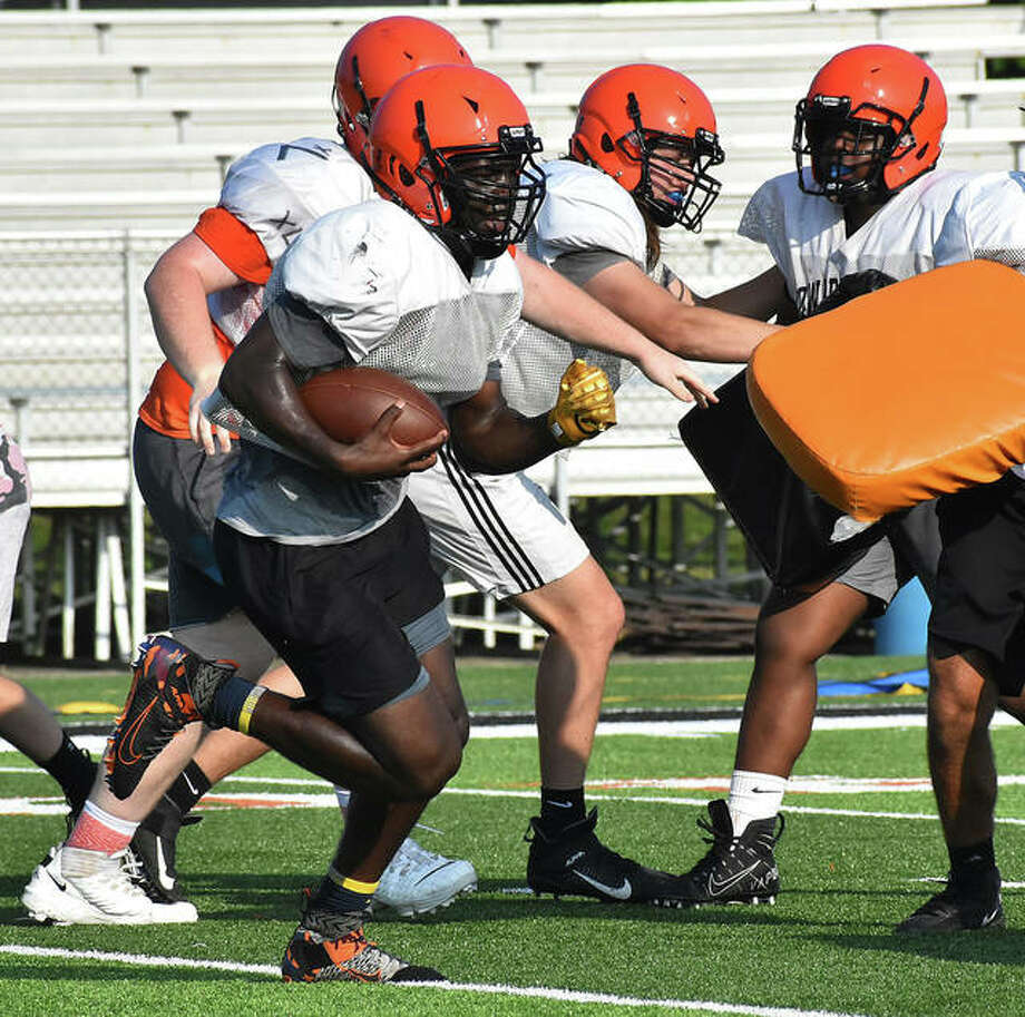 Edwardsville running back Justin Johnson Jr. looks for space during practice this summer before the guidelines were released that players must wear masks and no-contact drills were allowed. Photo: Matt Kamp|The Intelligencer
