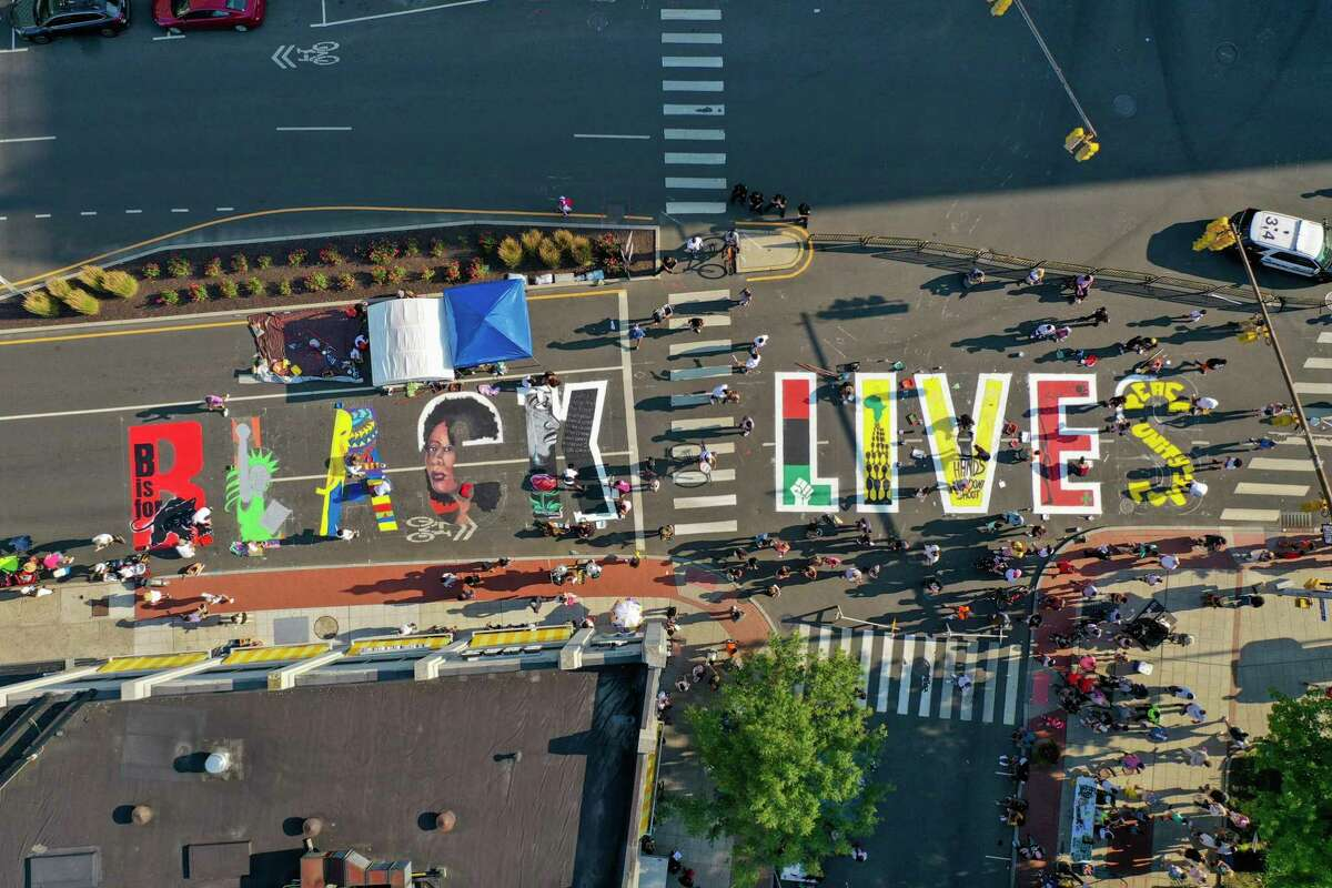 A Black Lives Matter mural is painted Sunday in downtown Stamford.