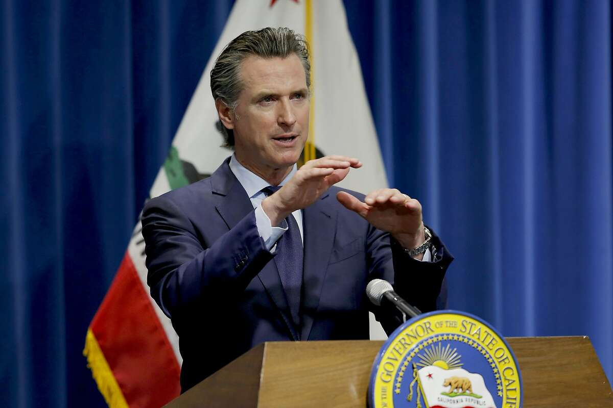 FILE - In this May 14, 2020, file photo, California Gov. Gavin Newsom discusses his revised 2020-2021 state budget during a news conference in Sacramento, Calif. Gov. Gavin Newsom announced Friday, July 17, 2020, that most counties will start the school year online due to soaring coronavirus cases and hospitalizations, but counties that have seen little of the virus, mostly towns and rural communities in California's north and east can bring students and teachers back to campus. (AP Photo/Rich Pedroncelli, Pool, File)