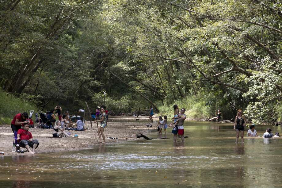 Families cooled off at Lake Houston Wilderness Park in New Caney after temperatures reached the mid 90's, Sunday, July 19, 2020. The park had adopted new policies to ensure the safety of it's staff and visitors such as encouraging social distancing and temperature checks. Photo: Gustavo Huerta/Staff Photographer / Houston Chronicle © 2020