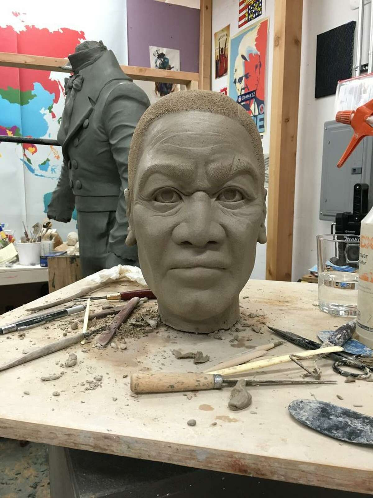 Statue of William Lanson, self taught 19th century Black entrepreneur, while it was under construction by sculptor Dana King