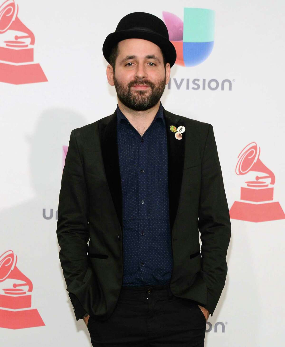 FILE - In this Nov. 19, 2015, file photo, Eduardo Cabra, of Calle 13, poses in the press room at the 16th annual Latin Grammy Awards in Las Vegas. Cabra killed off his