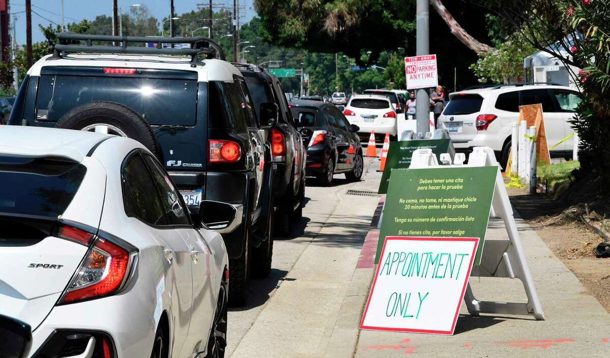 Drivers wait in line for entry to a COVID-19 drve-through test site in Los Angeles, California on July 17, 2020 as coronavirus cases have surged to record levels in Los Angeles County and surrounding areas in southern California. - The United States' COVID-19 epidemic is once more blowing up at an exponential rate, even as leaders of some of the worst-hit states resist mandatory mask measures to stem the spread. Health authorities reported 78,000 new cases on Thursday, according to the database run by Johns Hopkins University. (Photo by Frederic J. BROWN / AFP) (Photo by FREDERIC J. BROWN/AFP via Getty Images)