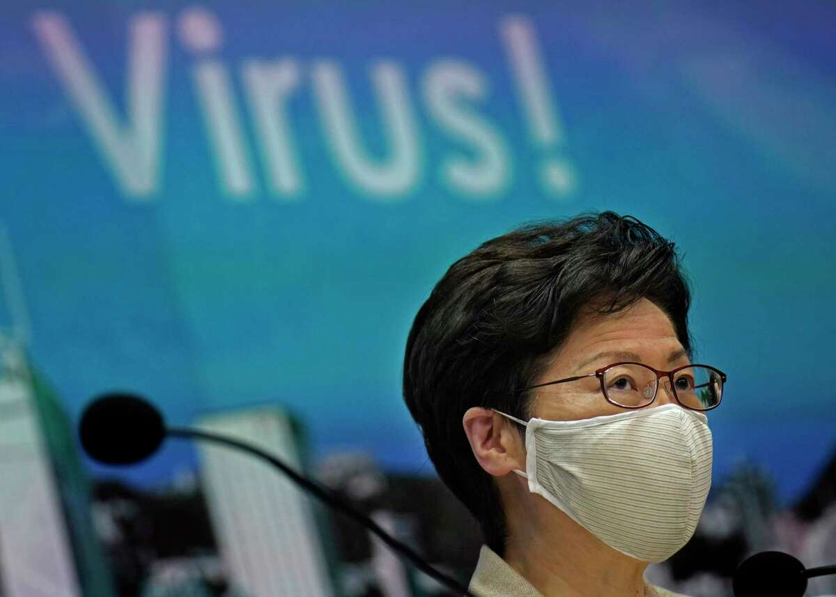 Hong Kong Chief Executive Carrie Lam listens to reporters questions during a press conference held in Hong Kong, Sunday, July 19, 2020. Lam introduced renewed anti-virus measures Sunday, saying the southern Chinese city's situation is
