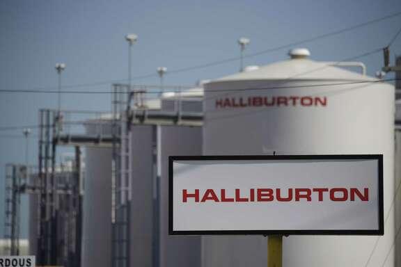 Halliburton signs stand alongside storage tanks in Port Fourchon, La., on June 11, 2020.