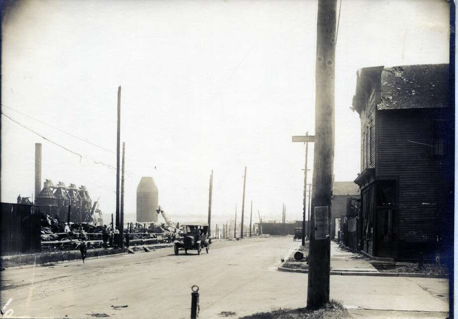 This photo looks east on Fifth Street (at the corner of Ramsdell Street) at the ruins of The Buckley & Douglas Lumber Co. several days after a fire destroyed the large campus of one of Manistee's busiest sawmills in 1920. Photo: Courtesy Photo/Manistee County Historical Museum