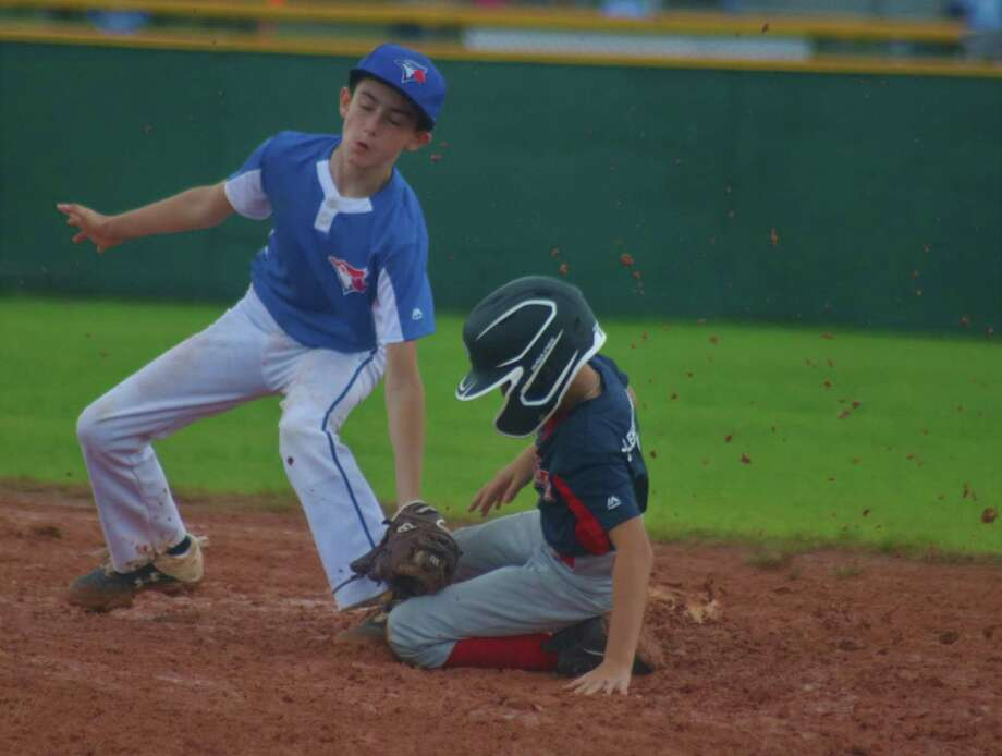 Indians runner Jace Regan successfully slides into second base, just ahead of the tag attempt by Chance Friedrich. Regan scored moments later to make it a 3-2 deficit, but then came a seven-hour rain postponement. Photo: Robert Avery