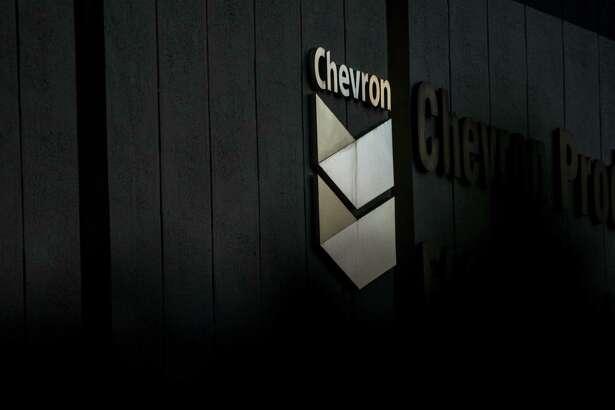 A Chevron sign at the company's El Segundo Refinery in El Segundo, Calif., on April 27, 2020.