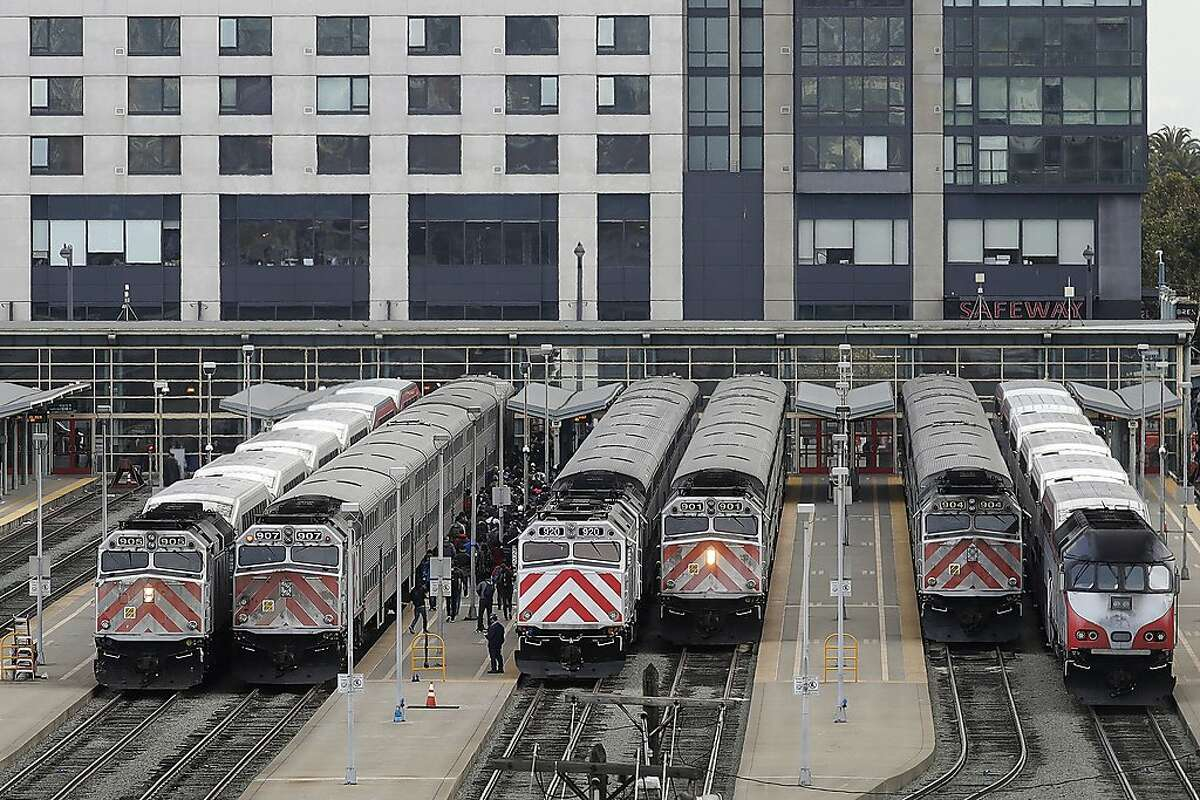 FILE - This Wednesday, Oct. 16, 2019, file photo shows trains at a Caltrain station in San Francisco. Transit systems have seen fare collections evaporate amid stay-at-home orders amid the coronavirus pandemic. Officials at Caltrain, a Bay area commuter rail line, said that they may have to end service after San Francisco supervisors blocked a tax increase to increase its subsidy. (AP Photo/Jeff Chiu, File)