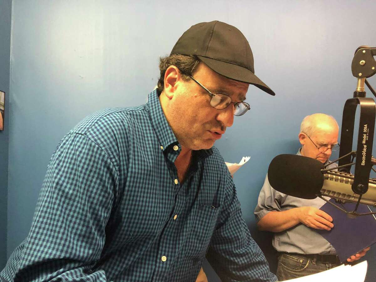 Phil Hall reads the part of Captain Ahab in a recording session for