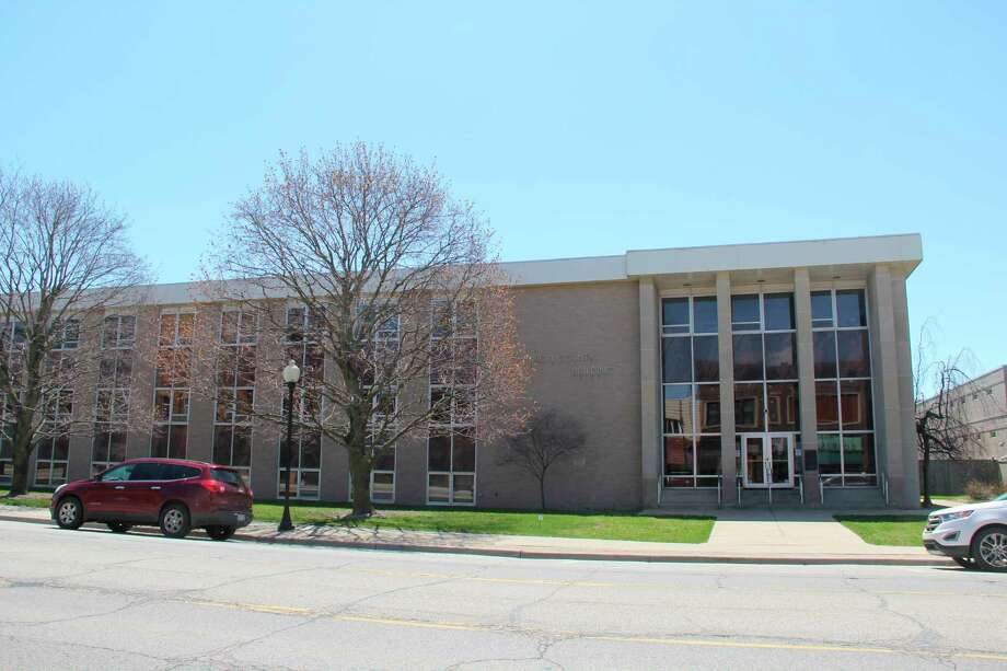 The Huron County Building in Bad Axe. Commissioner chairman Sami Khoury announced that its hours open to the public will change this week. (Tribune File Photo)